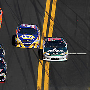 Sprint Cup Series driver Dale Earnhardt Jr. (88) gets pushed below the yellow safety line during the Daytona 500 Sprint Cup Race at Daytona International Speedway on February 20, 2011 in Daytona Beach, Florida. (AP Photo/Alex Menendez)