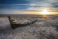 Remains of a boat buried in the beach