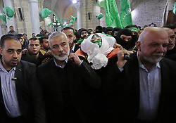 January 30, 2018 - Gaza City, Gaza Strip, Palestinian Territory - Hamas Chief Ismail Haniyeh carries the body of Hamas senior official Imad al-Alami during his funeral at the al-Omari mosque in Gaza City on January 30, 2018. A senior Hamas official has died in Gaza three weeks after shooting himself in the head in what officials described as an accident, the Palestinian Islamist group announced. Alami was wounded on January 9 while ''inspecting his personal weapon in his home'' in Gaza, Hamas said at the time  (Credit Image: © Ashraf Amra/APA Images via ZUMA Wire)