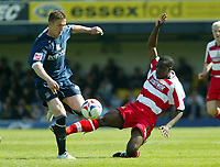 Photo: Chris Ratcliffe.<br />Southend United v Doncaster Rovers. Coca Cola League 1. 22/04/2006.<br />Freddie Eastwood (L) of Southend is tackled by Anthony Griffiths of Doncaster