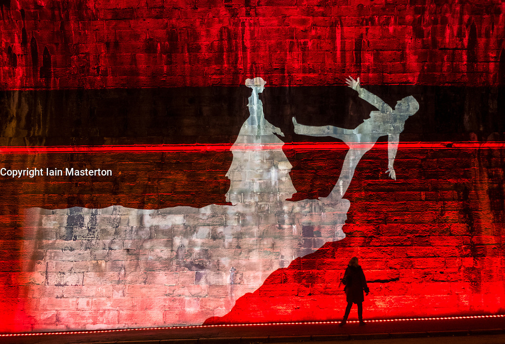 """Author Val McDermid's short story  """"New Year's Resurrection"""", Message from the Skies, projected at night at several locations in Edinburgh."""
