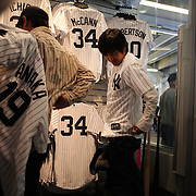 Japanese baseball fans in the Yankee Stadium shop buying shirts of Masahiro Tanaka on game day of Masahiro Tanaka, New York Yankees, pitching during the New York Yankees Vs Tampa Bay Rays, Major League Baseball game at Yankee Stadium, The Bronx, New York. 3rd May 2014. Photo Tim Clayton