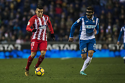 December 22, 2017 - Barcelona, Spain - BARCELONA, SPAIN - DECEMBER 22: 11 Angel Correa from Spain of Atletico de Madrid defended by 15 David Lopez from Spain of RCD Espanyol during the match of La Liga Santander between RCD Espanyol v Atletico de Madrid, at RCD Stadium in Barcelona on 22 of December, 2017. (Credit Image: © Xavier Bonilla/NurPhoto via ZUMA Press)