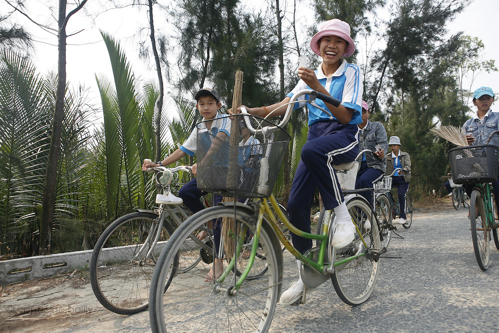 Hoi An, Vietnam. March 14th 2007..Kids come back from school in the village of Cam Thanh.