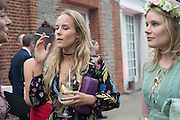 HUM FLEMING; TARKA RUSSELL;  2016 SERPENTINE SUMMER FUNDRAISER PARTY CO-HOSTED BY TOMMY HILFIGER. Serpentine Pavilion, Designed by Bjarke Ingels (BIG), Kensington Gardens. London. 6 July 2016