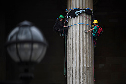 © Licensed to London News Pictures. 19/05/2016. London, UK. A Greenpeace protest by Greenpeace at the British museum which has closed the museum. Greenpeace climbers have scaled pillars at the museum, erecting banners protesting against BP sponsorship of Sunken Cities: Egypts - Lost Worlds exhibition at the museum. ‎Photo credit: Ben Cawthra/LNP