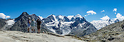 """Hike from Pontresina up Roseg Valley to Fuorcla Surlej for stunning views of Piz Bernina and Piz Rosegg, finishing at Corvatsch Mittelstation Murtel lift. Walking 14 km, we went up 1100 meters and down 150 m. Optionally shorten the hike to an easy 4 km via round trip lift. Pontresina is in Upper Engadine, in Graubünden (Grisons) canton, Switzerland, the Alps, Europe. The Swiss valley of Engadine translates as the """"garden of the En (or Inn) River"""" (Engadin in German, Engiadina in Romansh, Engadina in Italian). This image was stitched from multiple overlapping photos."""