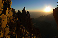 The sun rises over the windows section of Mount Whitney along the hiking trail to the 14,505-foot summit in the Sierra Nevada mountain range in California.