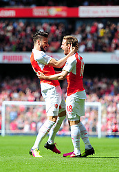 Olivier Giroud of Arsenal celebrates his goal with Nacho Monreal of Arsenal - Mandatory by-line: Dougie Allward/JMP - 15/05/2016 - FOOTBALL - Emirates Stadium - London, England - Arsenal v Aston Villa - Barclays Premier League