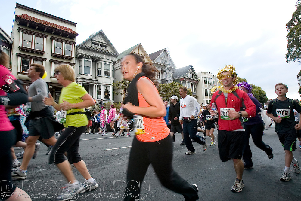 Runners make their way along Fell Street during the 100th Bay to Breakers 12K in San Francisco, Sunday, May 15, 2011. (Photo by D. Ross Cameron)