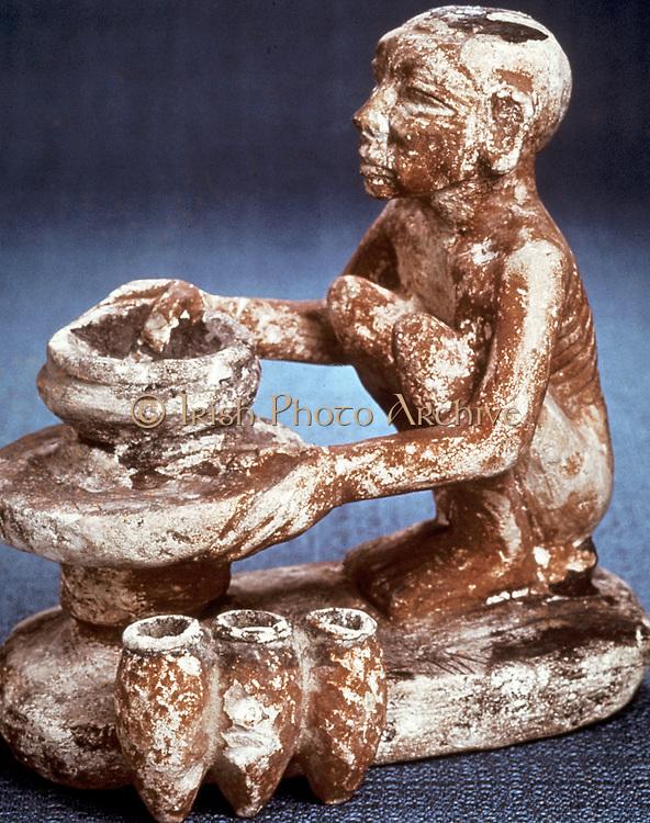 Potter turning vessels on a wheel:  Limestone model. Old Kingdom, 5th Dynasty (2565-2420 BC).