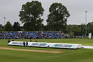 The covers are on at York Cricket Club as the rain starts to fall ahead of the Specsavers County Champ Div 1 match between Yorkshire County Cricket Club and Warwickshire County Cricket Club at York Cricket Club, York, United Kingdom on 17 June 2019.