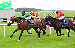 Castle Guest ridden by Robert Smithers (left) before winning the O'Brien's Wines Handicap at Curragh Racecourse, Co. Kildare, Ireland.