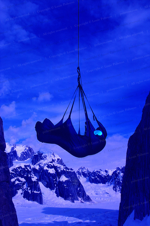 A climber uses goggles to sooth himself to sleep during a climb to Danali National Park, Alaska.