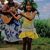 French Polynesia, Tahiti, Taha'a. Young Tahitian girl dances for tourists.