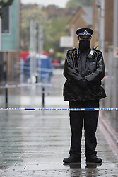 © Licensed to London News Pictures.  08/05/2021. London, UK. Police guard a crime scene after a man in his 30s has been murdered in Dalston, east London. Police were called at 00:56am to reports of shots fired in Gillett Square. Officers found a serously injured man. Despite the efforts of emergency services, the man was pronounced dead at the scene. Photo credit: Marcin Nowak/LNP