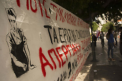 May 7, 2017 - Athens, Greece - Shops are sealed with banners placed by protesters to prevent them opening. Shop employees and leftists demonstrated at Ermou street, Athens' main commercial road, to protest over the greek government's recent agreement with its creditors to allow Sunday trading, thirty Sundays per year. (Credit Image: © Nikolas Georgiou via ZUMA Wire)