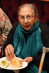 Portrait of an Asian woman eating,