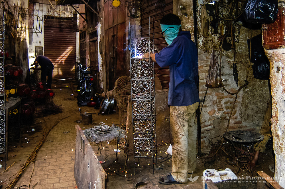 Morocco, Marrakesh. The famous souk which service both the common daily needs of the people of the city, and the tourist trade. Metalworkers.