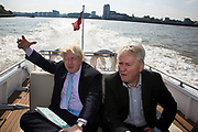 London, UK. Monday 8th September 2014. London Mayor Boris Johnson travelling down the Thames on the Silver Darling with Robert Gordon Clark, Chair of the Thames Festival Trust, after a visit to Royal Greenwich Tall Ships Festival which is organized by RB Greenwich. The Festival is included as a highlight of Totally Thames, the new month-long promotion of river and riverside events delivered by Thames Festival Trust.