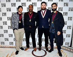 Rudimental's Kesi Dryden (left), DJ Locksmith (second left), Piers Agget (second right) and Amir Amor (right) attending the BMI London Awards at the Dorchester Hotel, London.