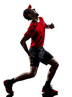 one young man runner jogger running injury pain cramps in silhouette isolated on white background