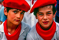 Basque boys wearing traditional colors at the Fiesta of San Fermin, Pamplona, Spain