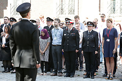 London Fire Brigade Commissioner Dany Cotton (red stripe hat) joins firefighters and LFB staff at Winchester House, in central London, to observe a minute's silence in memory of those people who died in last week's fire at Grenfell Tower.