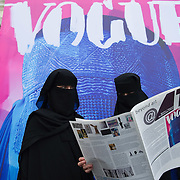 """VENICE, ITALY - JUNE 01:  Two models pose in front of Flavio Lucchini's work """"poster/vogue"""" part of the exhibition """"What Women Want (?)"""" on June 1, 2011 in Venice, Italy. The exhibition addresses the controversiat theme of the burqa"""