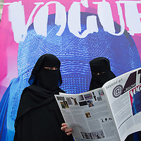 "VENICE, ITALY - JUNE 01:  Two models pose in front of Flavio Lucchini's work ""poster/vogue"" part of the exhibition ""What Women Want (?)"" on June 1, 2011 in Venice, Italy. The exhibition addresses the controversiat theme of the burqa"