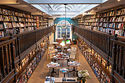 Interior showing two floors of floor to ceiling books and gifts on sale at Daunt Books on the 27th September 2019 in London in the United Kingdom.