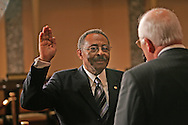 Roland Burris takes the oath to become a  United States Senator from Vice president Dick Cheney on January 15, 2009. Photo by Dennis Brack