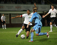 Photo: Rich Eaton.<br /> <br /> Hereford United v Coventry City. Carling Cup. 22/08/2006. Hereford skipper Tamika Mkandawire lunges for the ball ahead of Chris Birchall