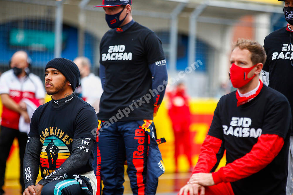 Lewis Hamilton (Mercedes) with Black Lives Matter t-shirt and Max Verstappen (Red Bull-Honda) and Sebastian Vettel (Ferrari) with End Racism t-shirts before the wet 2020 Turkish Grand Prix at Istanbul Park. Photo: © Copyright: FIA Pool Image via Grand Prix Photo - for Editorial Use Only