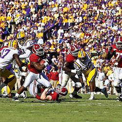 November 6, 2010; Baton Rouge, LA, USA; Alabama Crimson Tide running back Trent Richardson (3) runs against the LSU Tigers during the first half at Tiger Stadium.  Mandatory Credit: Derick E. Hingle