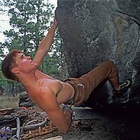 Rock climber Alec Tkach attempts difficult moves on a boulder In Whiskey Gulch, near Butte, Montana.