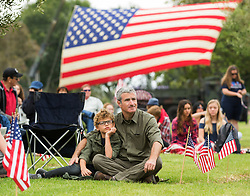 May 29, 2017 - Costa Mesa, CA, USA - Teddy Rubin of Laguna Beach sits with his father Gerry Rubin during the 63rd Annual Memorial Day Services at Harbor Lawn-Mount Olive Memorial Park on Monday, May 29, 2017 in Costa Mesa, Calif. ''We're here to pay our respects to those who served.'' said Gerry. (Credit Image: © Josh Barber Josh Barber/The Orange County Register via ZUMA Wire)