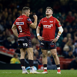 Scarlets' Steff Evans with team-mate Gareth Davies<br /> <br /> Photographer Simon King/Replay Images<br /> <br /> Guinness PRO14 Round 21 - Dragons v Scarlets - Saturday 28th April 2018 - Principality Stadium - Cardiff<br /> <br /> World Copyright © Replay Images . All rights reserved. info@replayimages.co.uk - http://replayimages.co.uk