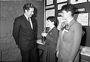 05/01/1989.01/05/1989.5th January 1989.The Aer Lingus Young Scientist of the Year Award at the RDS, Dublin ..Picture shows Michael Smith, T.D., Minister for Energy with a pupil(unkown) and her exhibit in the Environmental and Social Science Section. Louise Curran of Aer Lingus is also in picture.