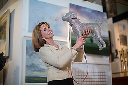 © licensed to London News Pictures. London, UK 11/04/2013.  Jane Asher posing with an artwork dog  which symbolises Hearing Dogs charity as she opens The Chelsea Art Fair at Chelsea Old Town Hall in London. The art fair offering contemporary and modern works of art from £500 to £20,000 and runs until April 14. Photo credit: Tolga Akmen/LNP