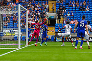 Bournemouth goalkeeper Mark Travers (42) saves from Cardiff City forward Mark Harris (29) during the EFL Sky Bet Championship match between Cardiff City and Bournemouth at the Cardiff City Stadium, Cardiff, Wales on 18 September 2021.