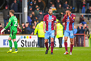 Rory McArdle of Scunthorpe United (23) and James Perch of Scunthorpe United (14) react after losing 3-2 during the EFL Sky Bet League 1 match between Scunthorpe United and Bradford City at Glanford Park, Scunthorpe, England on 27 April 2019.