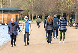 """© Licensed to London News Pictures. 24/02/2021. London, UK. Members of the public enjoy the sunshine and mild temperatures this morning in Hyde Park, London as weather forecasters predict a warm and sunny week ahead with highs of 17c in London today. This week, Prime Minister Boris Jonson announced his """"Roadmap Map' out of Lockdown with a gradual easing of Covid-19 restrictions with shops, pubs and gyms to open by April, Rule of Six and schools back by March and nightlife back by June. Photo credit: Alex Lentati/LNP"""
