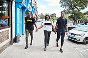 CLONDALKIN, IRELAND - August 13, 2018:  Aidan's mother Nibo is excited to have her boys back in town as they shop and walk through the neighborhood.<br /> <br /> Aidan Harris-Igiehon was born in Ireland. Aidan moved to the United States at the age of 12 to pursue his dreams of becoming a professional basketball player. Growing up in Ireland, basketball is not a traditional sport in the country so once Aidan saw some promise and potential he knew that moving to America was his only option. At the age of 12 Aidan had already outgrown his classmates and even dunked his first basketball in middle school. He had to leave his mother in Ireland and went on to live with his Aunt and Uncle in Brooklyn, NY where he would being to start a new life and pursue basketball. <br /> <br /> Aidan had went on to refine his skills and continue to grow - 6'10 240 pounder by the time he was a junior at Lawrence Woodmere Academy in New York. He became a top 50 National prospect and sought after by colleges across the country. This is Aidan's first time seeing his family and friends in 2 years and the first back home since all of the national recognition. Ireland had scheduled a week long of camps and exhibitions that would be featuring Aidan.<br /> <br /> Photo by: Johnnie Izquierdo