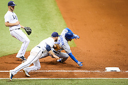 August 24, 2017 - St. Petersburg, Florida, U.S. - WILL VRAGOVIC       Times.Toronto Blue Jays left fielder Ezequiel Carrera (3) dodges the tag attempt by Tampa Bay Rays first baseman Lucas Duda (21) in the seventh inning of the game between the Toronto Blue Jays and the Tampa Bay Rays at Tropicana Field in St. Petersburg, Fla. on Thursday, Aug. 24, 2017. (Credit Image: © Will Vragovic/Tampa Bay Times via ZUMA Wire)