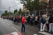 Celebration of the illegal referendum of Catalonia the 1th October. People have come to schools early at 5:30 am to keep the police from closing the school before voting starts. Long queues have built up at the door until the school has opened at 9:00 am. The first two hours in the morning there have been many informatic problems with the application to count the votes. People expected frustrated thinking that they could not vote. While in some schools of Barcelona and Sant Julià de Ramis there have been police charges, in Mataró people were voting under the threat of receiving a visit from the Civil Guard or the National Police and closing the schools. The Thos i Codina Institute of Mataró has organized activities in the afternoon to gather people and avoid closure. Finally, in the city of Mataró, no ballot boxes have been requisitioned and the final count has been made, with a 90.1% vote in favor of Catalonia's independence. Photo: Eva Parey/4SEE.