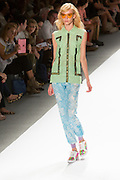 Print pants with elastic cuffed hem and lace top. By Custo Barcelona at the Spring 2013 Fashion Week show in New York.