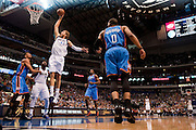 Dirk Nowitzki (41) of the Dallas Mavericks dunks the ball against the Oklahoma City Thunder at the American Airlines Center in Dallas on Sunday, March 17, 2013. (Cooper Neill/The Dallas Morning News)
