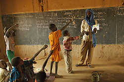 Abouleacrine ag Tadima teaches children basic health in his classroom in the  village of Intedeyne March 15, 2007.    the challenge to educate children in Mali still exists and particularly for girls. Female literacy rates never reach even 50 percent of male literacy rates. Mali has the highest percentage of people living below the poverty line in any country in the world. Ninety percent of Malians survive on less than two dollars a day.