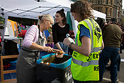 Extinction Rebellion climate change activists operate the food kitchen as sites around Westminster are blocked on 8th October 2019 in London, England, United Kingdom. Extinction Rebellion is a climate group started in 2018 and has gained a huge following of people committed to peaceful protests. These protests are highlighting that the government is not doing enough to avoid catastrophic climate change and to demand the government take radical action to save the planet.